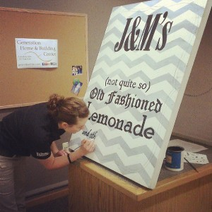 painting the lemonade stand sign